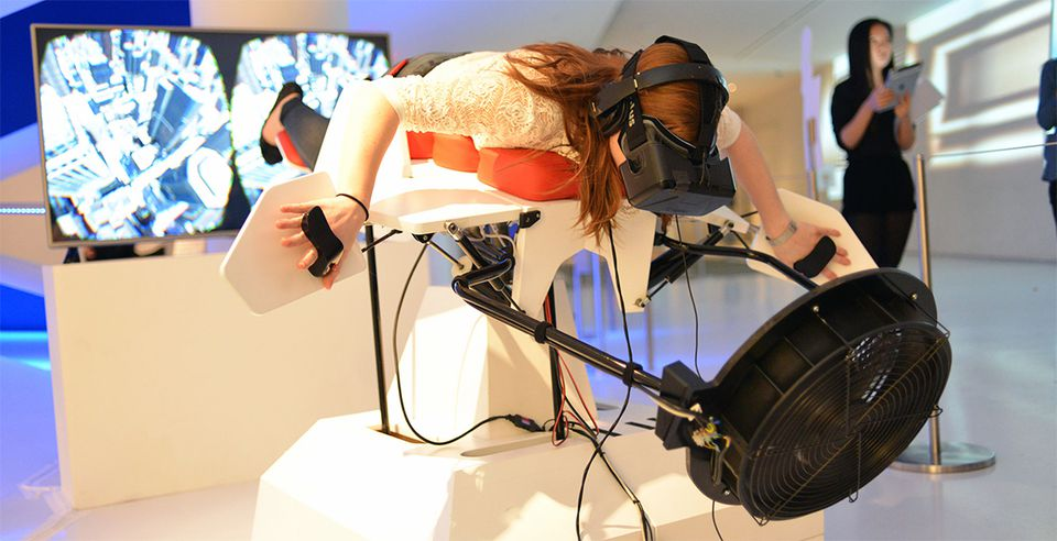 A user tries out Birdly, a virtual reality device that  lets people experience what it's like to be a bird soaring through New York City.