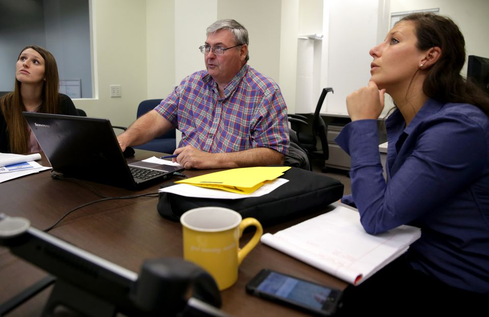 Estimators from Cannistraro and Harrington Air Systems, a sister company, look over plans and schematics to prepare a bid for a job. From left to right: Michelle Godlewski, Cort Naegelin of Harrington, and Kourtney Mierzejewski.
