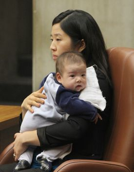 Boston City Councilor Michelle Wu held her 11-week-old son during a hearing on Boston's Olympics bid on March 6.