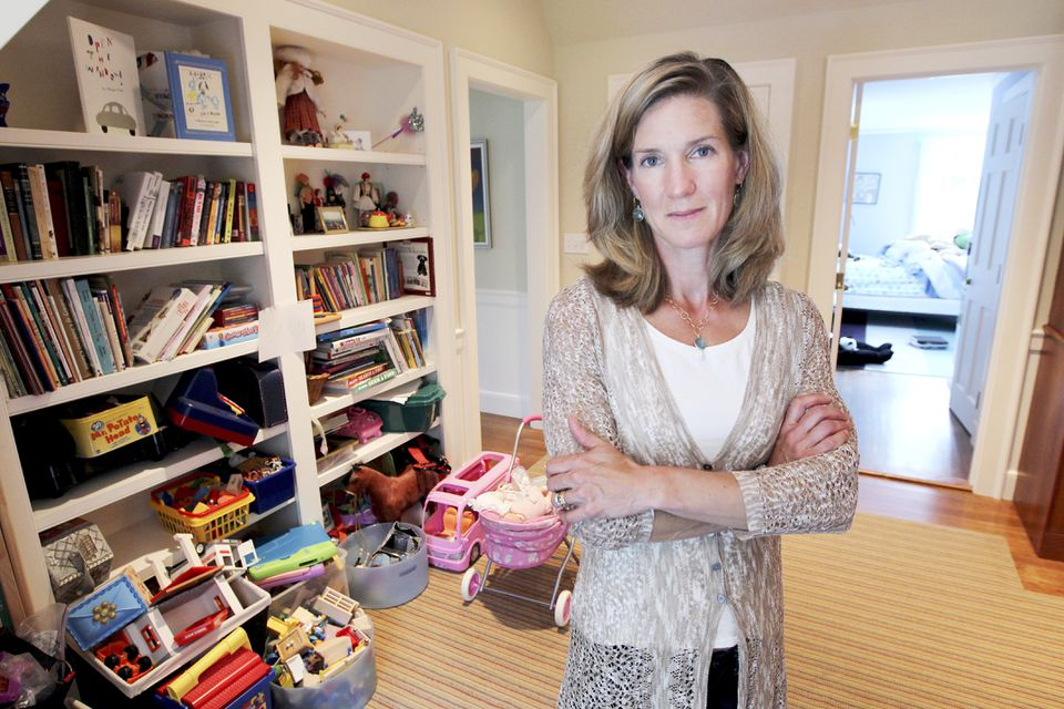"""Jessica Pohl of Weston has kids who have largely outgrown their toys, but she can't give them away. """"I'm saving them for my grandchildren."""""""