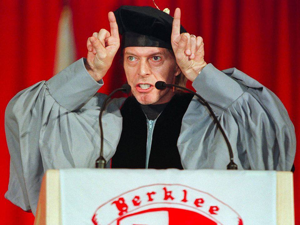 David Bowie gestured during his commencement speech at Berklee College of Music in 1999.