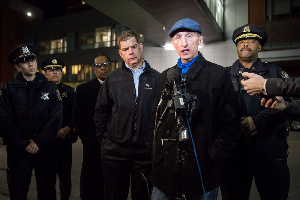 "Boston Police Commissioner William B. Evans (center) said that the boy's father believed himself to be the target. ""It's sad when these feuds are carried out,"" Evans said."