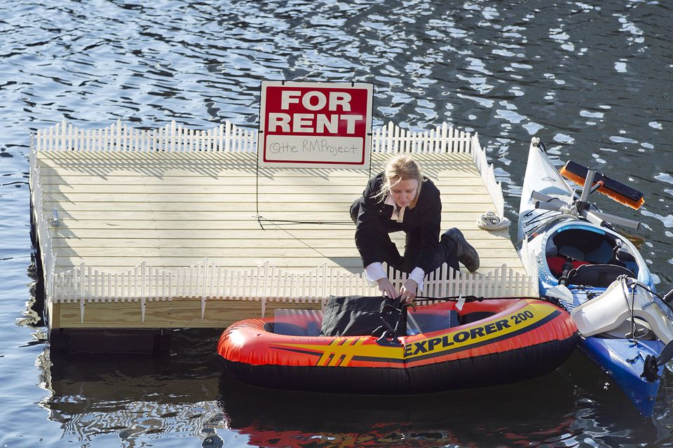 """Heidi Kayser on her raft in Fort Point Channel for """"The Remodeling Project."""""""