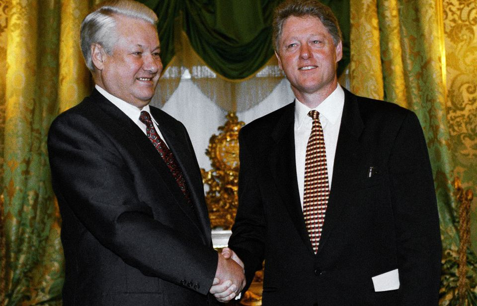 Boris Yeltsin, then president of Russia, welcomes Bill Clinton to St. George's Hall at the Kremlin Palace on Jan. 13, 1994.