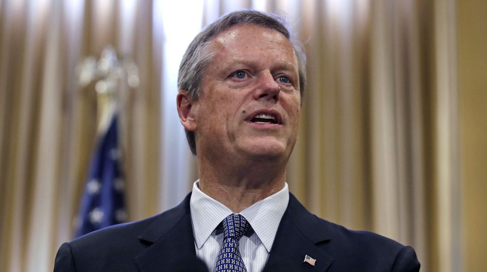 Governor Charlie Baker addresses reporters at the State House on July 26.