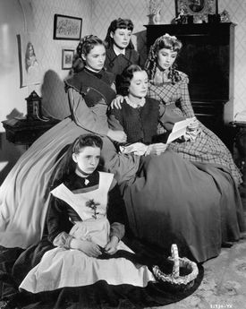 "Marmee, played by Mary Astor, reads to her daughters in MGM's 1949 production of ""Little Women."""