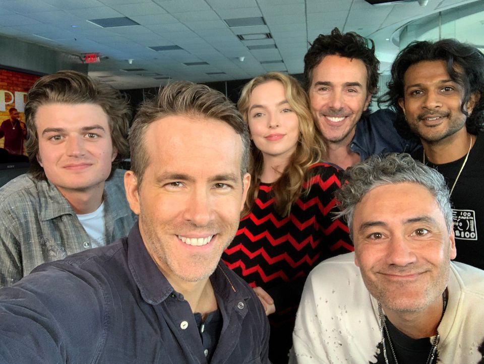 "The cast of the new film ""Free Guy"" includes (left to right) Joe Keery, Ryan Reynolds, Jodie Comer, ""Free Guy"" director Shawn Levy, Taika Waititi, and Utkarsh Ambudkar."