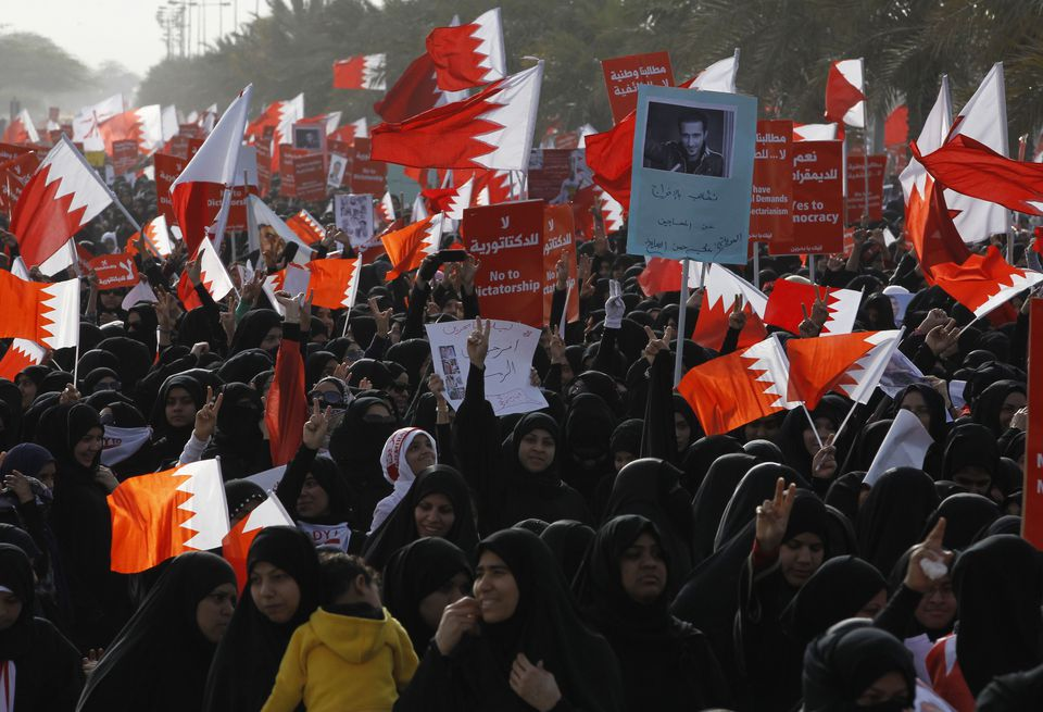 Tens of thousands of demonstrators flooded the streets of Budaiya, Bahrain, on Friday in support of a Shi'ite-led rebellion against the country's Sunni monarchy, stepping up pressure on the US-allied government with one of the largest protests in months.