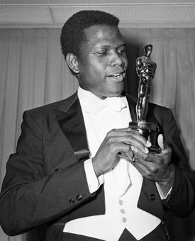Actor Sidney Poitier was photographed with his Oscar statuette, 1964.