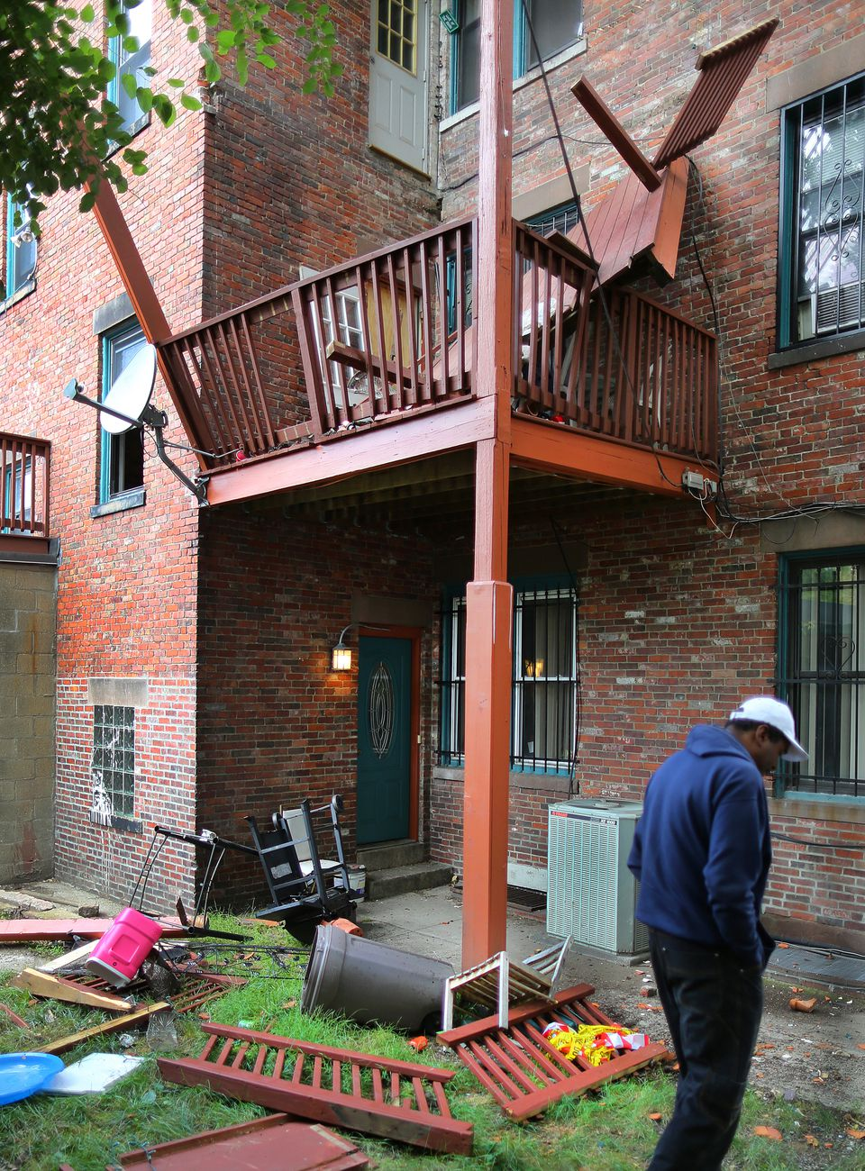A Museum of Fine Arts student and 11 others were injured after this illegal third floor deck in Mission Hill collapsed. The city later cited the property owner.