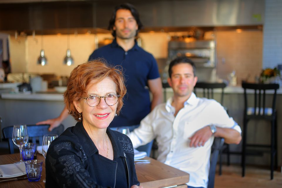 Jody Adams with partners Eric Papachristos (standing) and Sean Griffing at Porto.