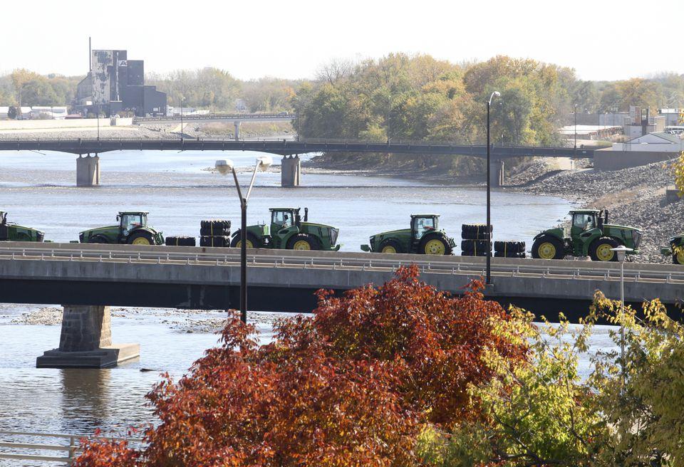John Deere tractors, long a symbol of the Waterloo, Iowa, economy, were transported by rail across the Cedar River.
