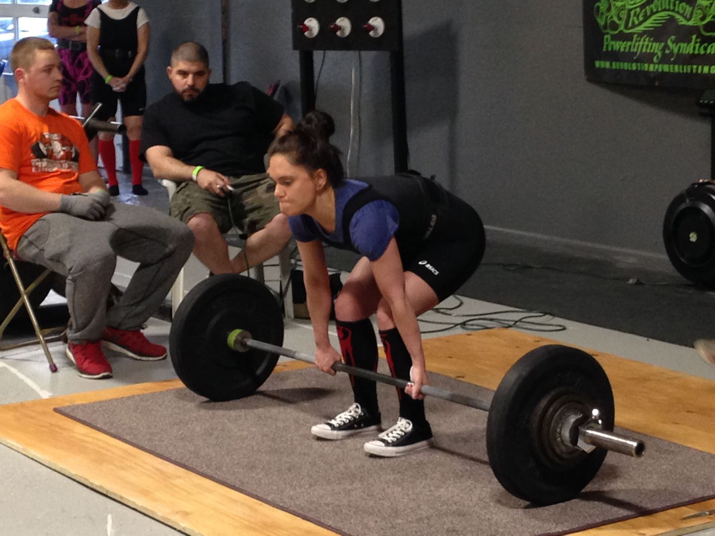 Devoted to fitness, Laura worked out six days a week and competed in organized powerlifting competitions.