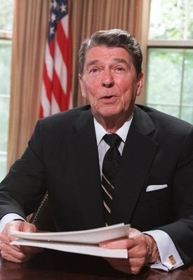 President Ronald Reagan poses for photographers in the Oval Office at the White House on June 23, 1986.