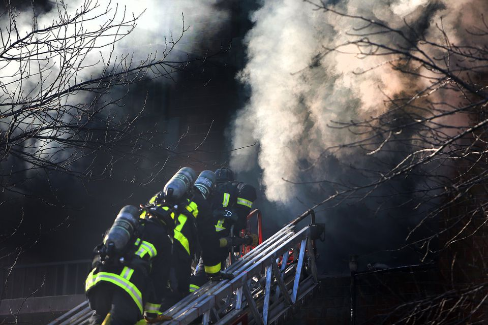 Boston firefighters battle a smoky fire at an elderly housing building in Brighton on Feb. 14.