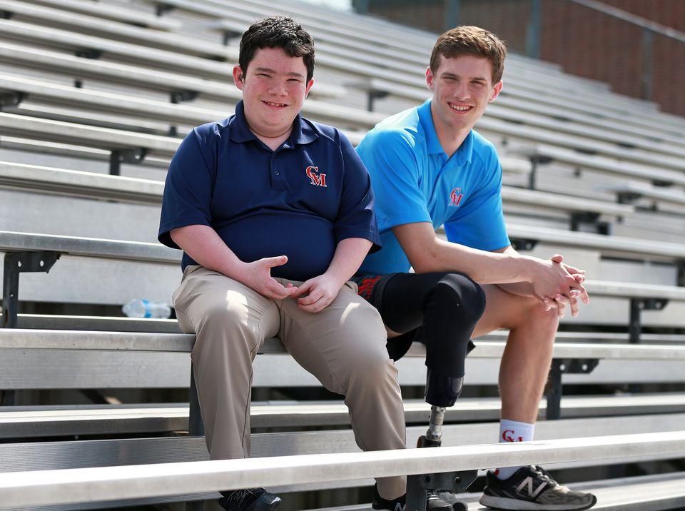 Brendan Cogavin (left) and Matt Freitas in the athletic field's bleachers at Catholic Memorial High School in West Roxbury.