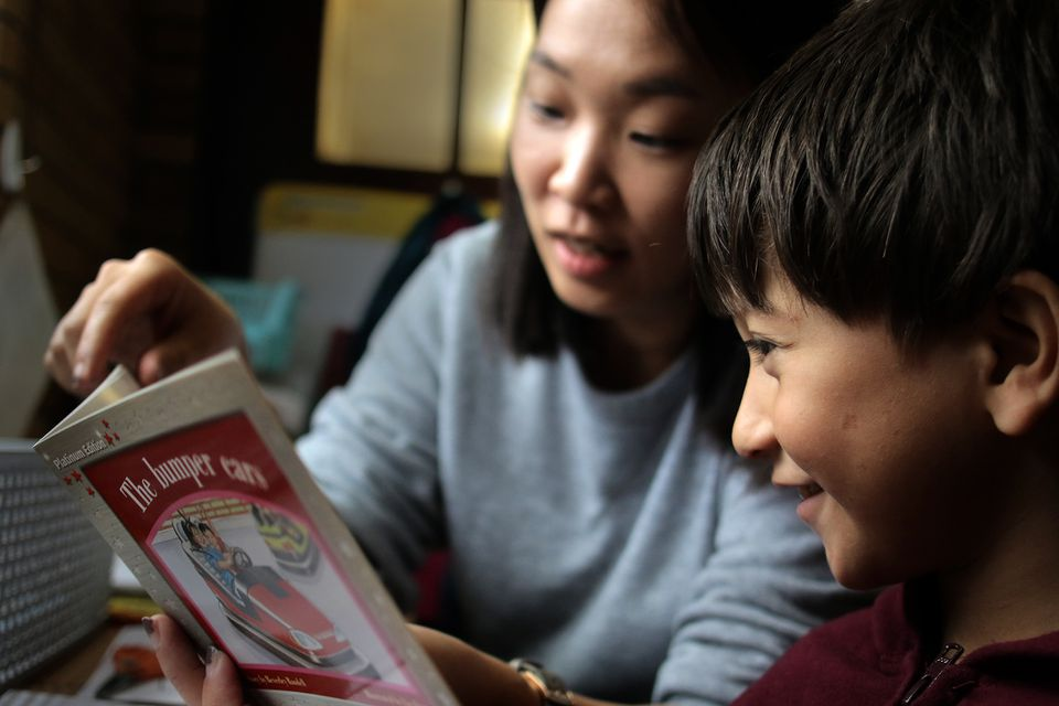 Estevan Vilorio worked with teacher Jeesun Yoo in a reading program at the Kennedy School.