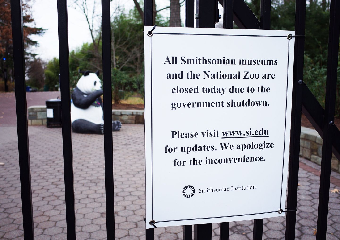 A sign on the main gate of the Smithsonian's National Zoo announced the Zoo will be closed during the shutdown.
