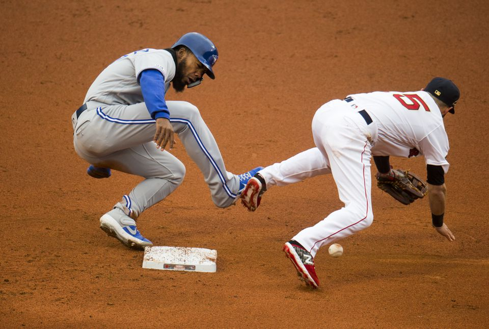 Toronto's Teoscar Hernandez and Pedroia came together on a stolen base, causing momentary concern at Fenway.