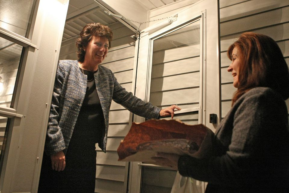 Gayle Cipitelli, a volunteer with Neighbor Brigade, delivered dinner to Patty and Doug Oakley's home in West Bridgewater recently. The volunteer group helps people in need with day-to-day tasks like meals.