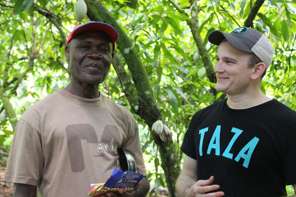 Farmer Antoine Josef with Jesse Last of Taza Chocolate.