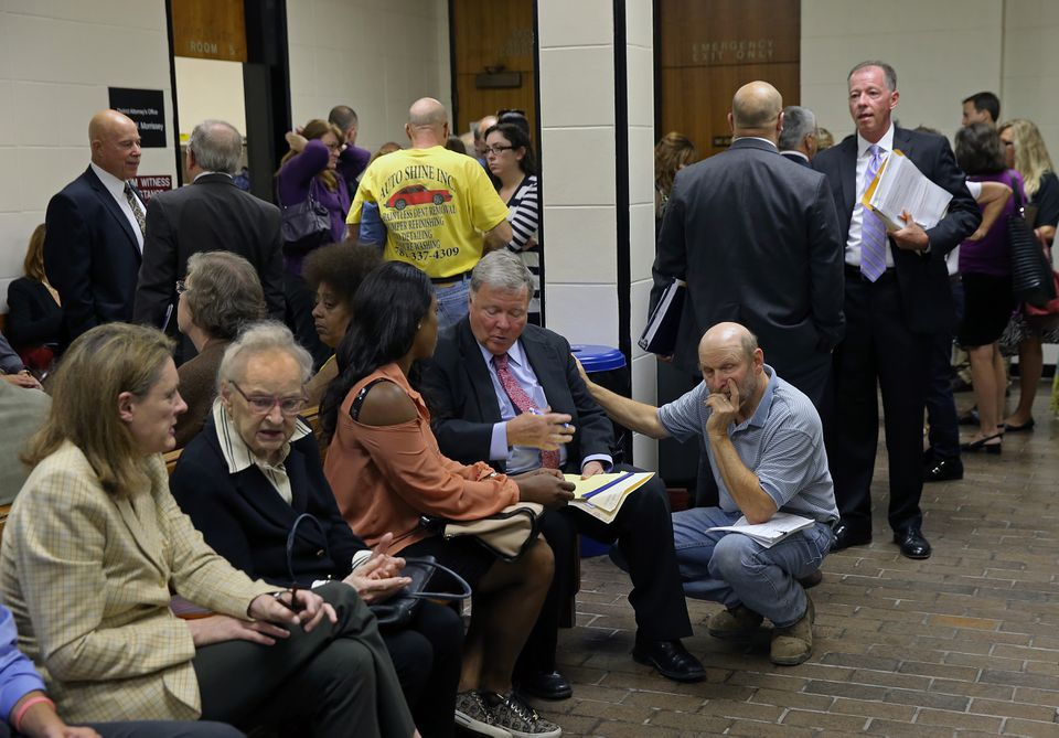 Lawyers met with clients in a crowded, noisy second-floor lobby of the Quincy District Court.
