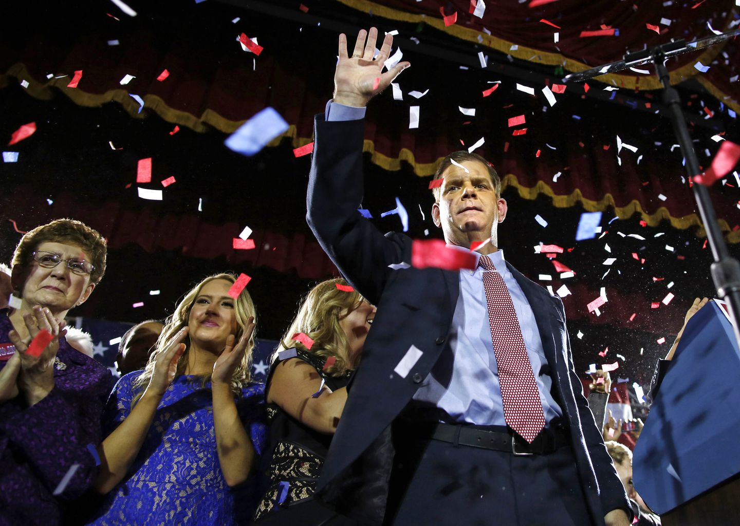 Walsh celebrates with his longtime partner, Lorrie Higgins, her daughter, Lauren, and his mother, Mary, at his election night party at the Park Plaza Hotel in 2013.