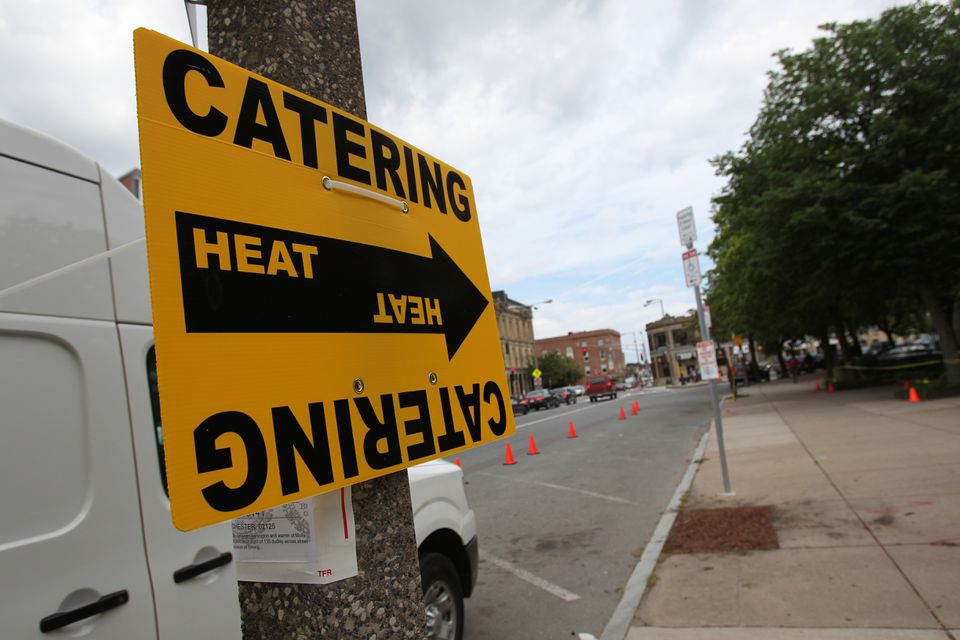 """A catering sign for the crew of """"The Heat,"""" the new Sandra Bullock movie filming in Dudley Square. (Suzanne Kreiter/Globe Staff)"""