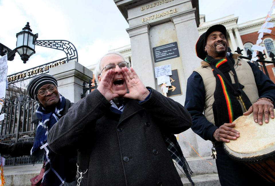 Community activist Lew Finfer addressed a crowd of more than 100 who gathered on Friday at the State House to commemorate the protest 50 years ago that halted the Inner Belt highway project.