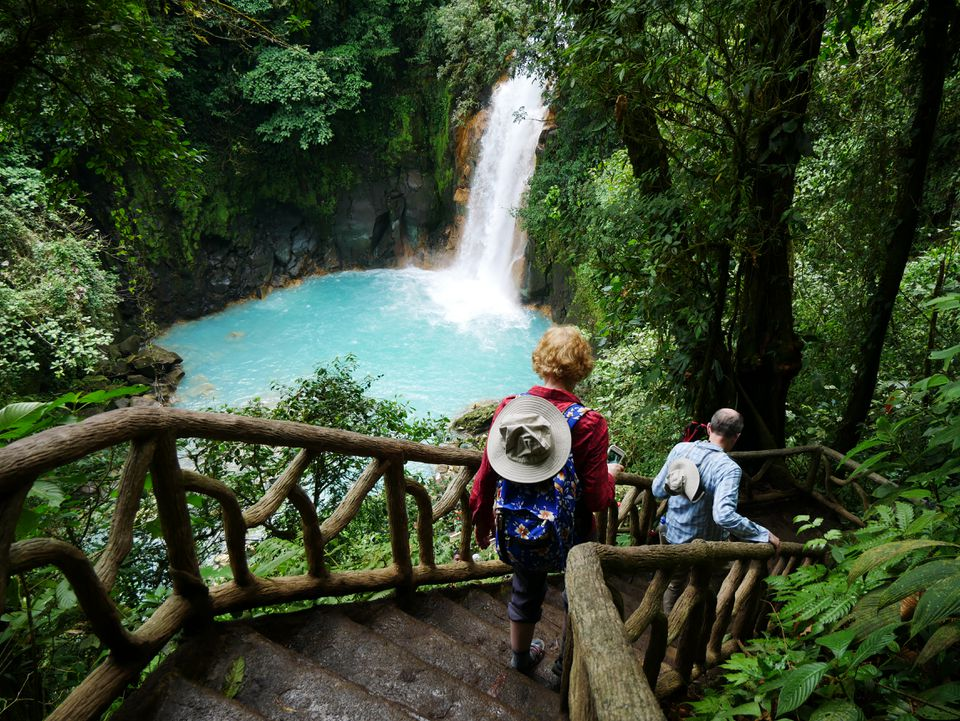 The writer's parents hike down to a waterfall in Tenorio Volcano National Park.