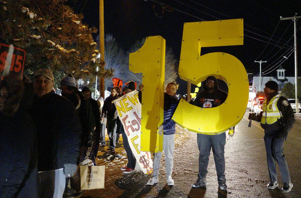 Protesters advocated for a $15-per-hour national minimum wage march outside the Republican presidential debate site in Manchester, New Hampshire last month.