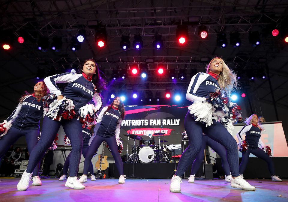 The Patriots cheerleaders performed at Saturday's Super Bowl rally in Centennial Olympic Park.