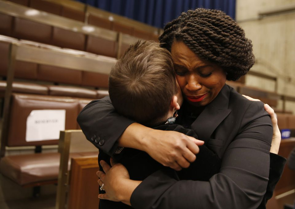 Congresswoman-elect Ayanna Pressley embraced her former chief of staff, Jessica Taubner, following a farewell at City Hall.