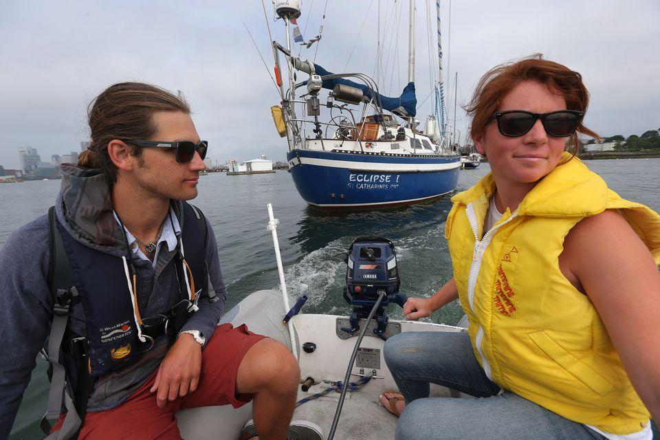 Ali Wisch and boyfriend Phillip Gutowski commute by dinghy from their boat.