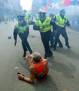 Tlumacki took this image about five seconds after the first bomb exploded at the Boston Marathon finish line. The force of the blast caused 78-year-old runner Bill Iffrig to fall; meanwhile, Boston Police's Rachel McGuire, Kevin McGill, and Javier Pagan sprang into action.