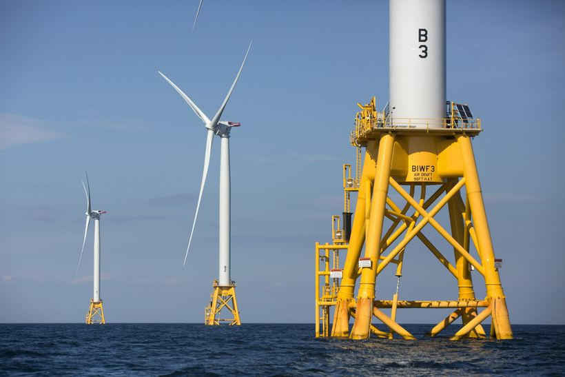 Three wind turbines from the Deepwater Wind project stand off Block Island, R.I.