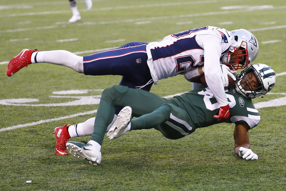 Safety Patrick Chung brings down Jets wide receiver Trenton Cannon after a reception in the Patriots' 27-13 victory on Nov. 25.