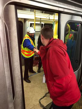 MBTA General Manager Steve Poftak greeted a crew member of a new Orange Line train during a test on Friday.