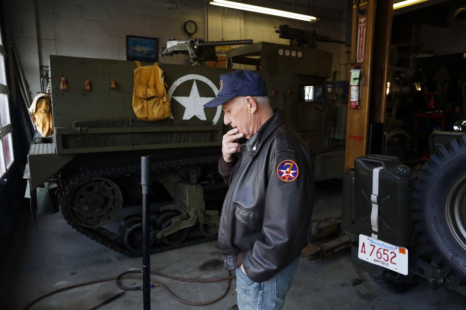 Richie Duval paused in his Winthrop garage in front of a 1943 M3 half track, which he and other veterans restored.