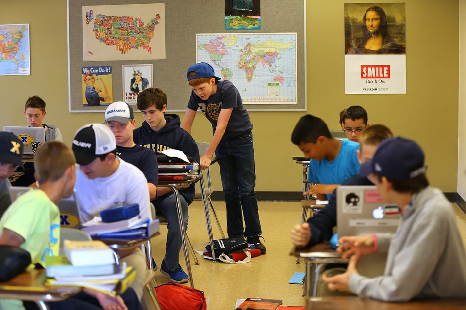 Xaverian Brothers High seventh-graders chatted during open study class earlier this month.