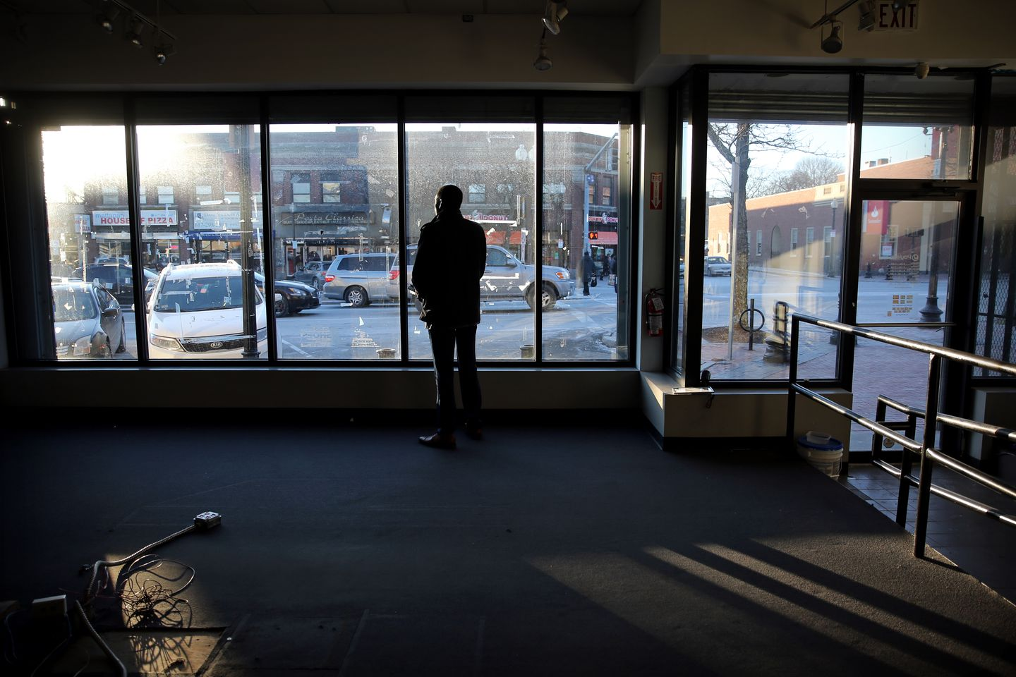 Chauncy Spencer stood in the space — a former Payless shoe outlet — where he hopes to open his marijuana store.