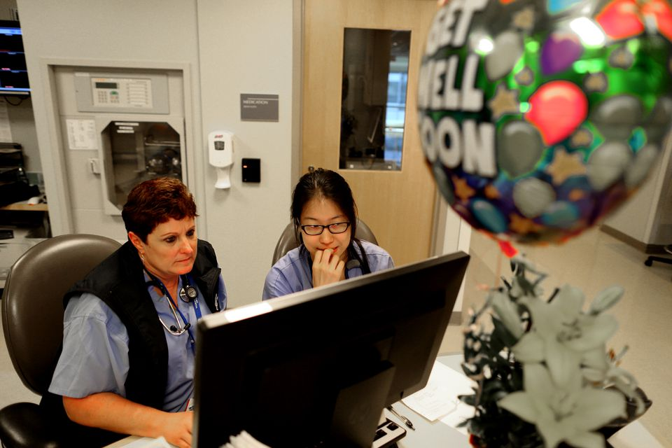 Surgical nurses Linda B. France (left) and Shawnee Song worked on a new IT system.