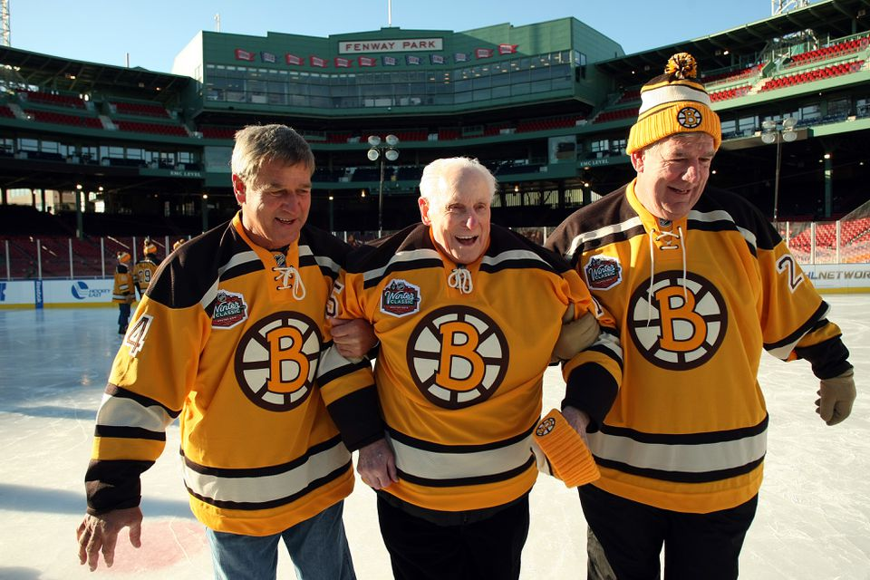 Milt Schmidt (center) took to the ice with fellow Bruins legends Bobby Orr (left) and Terry O'Reilly in 2009.