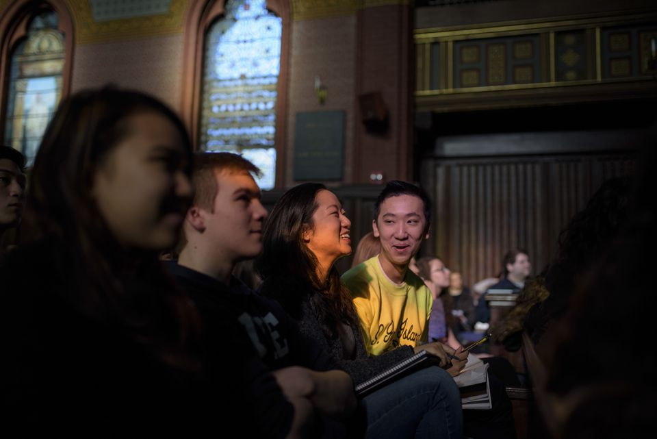 """Jennifer Chen, left, and Sean Guo laughed during their """"Psychology and the Good Life"""" class in Battell Chapel at Yale University."""