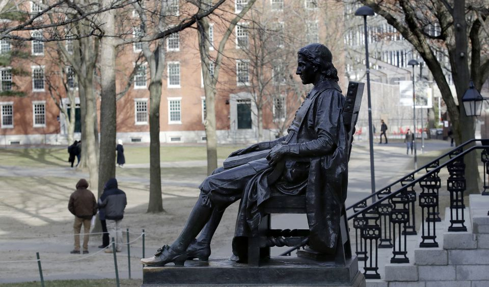The John Harvard statue at Harvard University. Mark Riddell studied at Harvard, where he dazzled as an NCAA Division I tennis player.