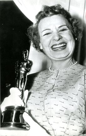 Shirley Booth winner of the 1953 Academy Award for best performance by an actress was holding the Oscar trophy.