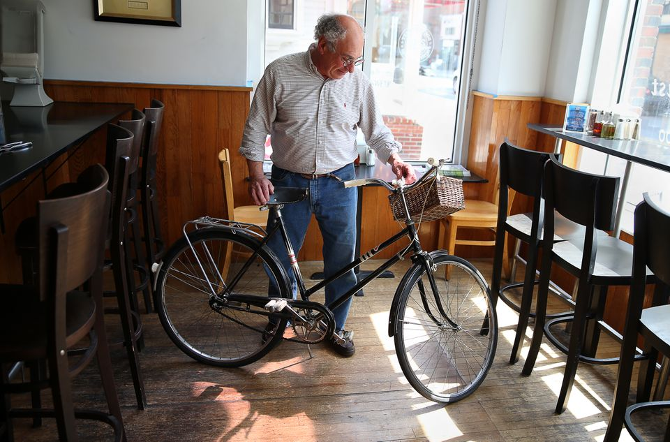 Al Carvelli at his restaurant, which he now calls Top Crust, in Plymouth. The bicycle used to sit in a window as an icon of the eatery when in was called Upper Crust. He removed it in honor of the restaurant's new name.