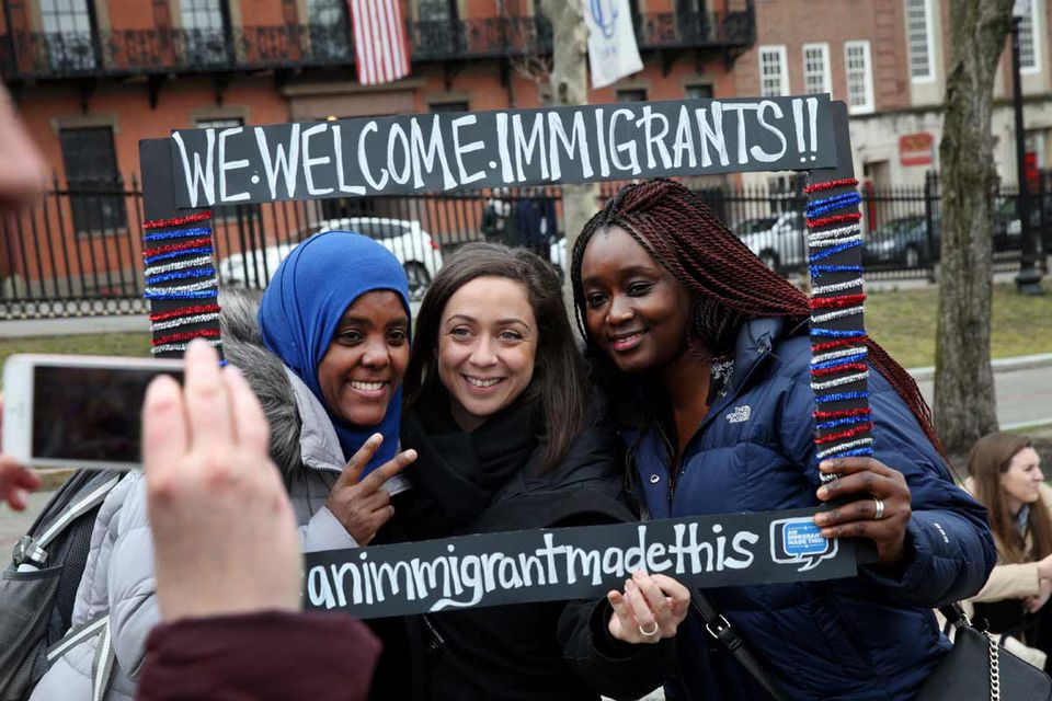 Birchat Kedir of Ethiopia, Olivia Meyerhoffer of France, and Mariama Cire Sylla of Guinea (from left) at an immigration rally on the Boston Common during the 21st annual Immigrants' Day at the Massachusetts State House on April 5, 2017.