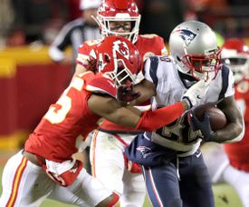 Patriots running back James White powered through the tackle of Chiefs cornerback Charvarius Ward.