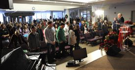 Students listened to President Charles Crabtree (far right) during a morning service.